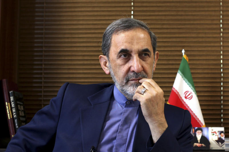 In this Sunday, Aug. 18, 2013 photo, Ali Akbar Velayati, a top adviser to Iran's supreme leader Ayatollah Ali Khamenei, gives an interview to The Associated Press at his office, in Tehran, Iran. Velayati says the election of moderate President Hasan Rouhani has provided a good opportunity for world powers to reach a deal over Iran's nuclear program. Velayati, who advises Ayatollah Ali Khamenei on key matters including the nuclear issue, tells The Associated Press that the Islamic republic will never again suspend its nuclear activities but will employ new tactics to reach out to the world to find a common language. (AP Photo/Ebrahim Noroozi)