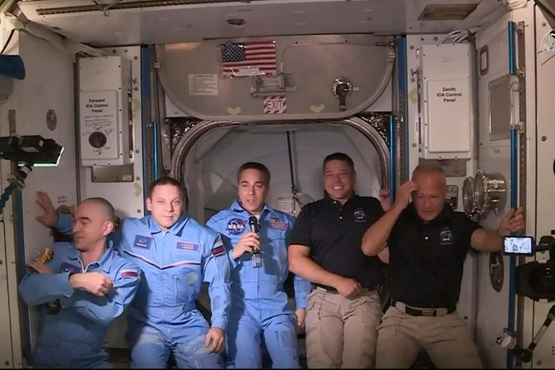 From right: Doug Hurley and Bob Behnken join the Expedition 63 crew (NASA TV/AFP via Getty Images)
