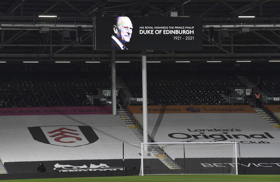 A tribute to Britain's Prince Philip, Duke of Edinburgh is featured on a billboard ahead of the English Premier League soccer match between Fulham and Wolverhampton Wanderers at Craven Cottage stadium in London, England, Friday, April 9, 2021.(Glyn Kirk/Pool via AP)