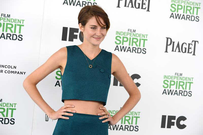 "FILE - In this Saturday, March 1, 2014 file photo, Shailene Woodley arrives at the 2014 Film Independent Spirit Awards in Santa Monica, Calif. Woodley is known for her hugs. The 22-year-old ""Divergent"" star gives hearty embraces - often more than one - to everyone she meets. (Photo by Jordan Strauss/Invision/AP, file)"