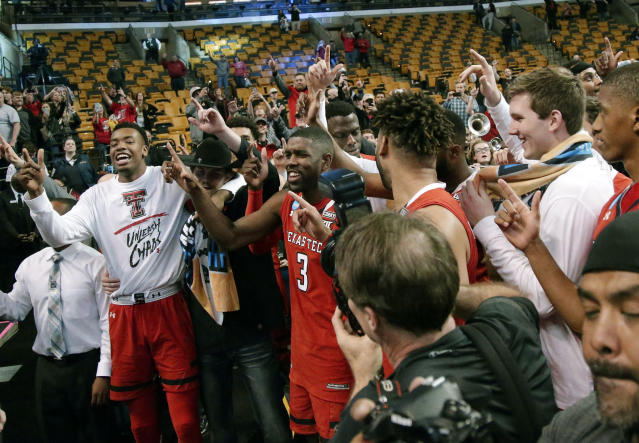 Texas Tech celebrates after defeating Purdue 78-65 in an NCAA men's college basketball tournament regional semifinal, early Saturday, March 24, 2018, in Boston. (AP Photo/Mary Schwalm)