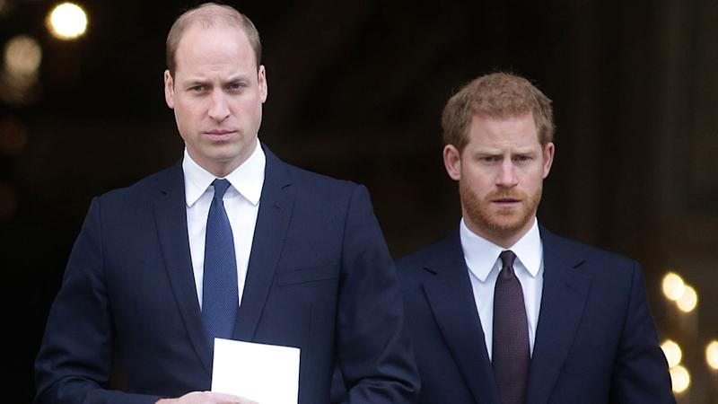 Prince William Prince Harry in sombre black suits