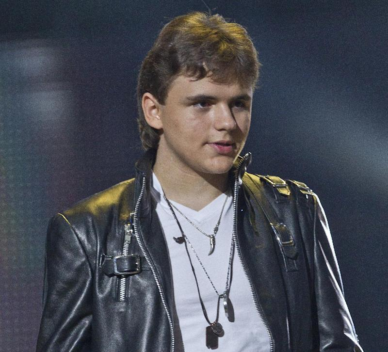 FILE - In this Oct. 8, 2011 file photo, Prince Michael Jackson appears on stage at the Michael Forever the Tribute Concert, at the Millennium Stadium in Cardiff. An attorney for Michael Jackson's mother, Katherine Jackson, says the singer's eldest son, Prince, will testify in a Los Angeles courtroom in the negligent hiring case against AEG Live LLC on Wednesday, June 26, 2013. Prince, 16, is a plaintiff in the case against concert promoter AEG Live. (AP Photo/Joel Ryan, File) *Editorial Use Only*