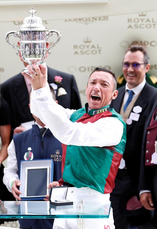 Horse Racing - Royal Ascot - Ascot Racecourse, Ascot, Britain - June 19, 2018 Frankie Dettori celebrates with a trophy after winning the 4.20 St James's Palace Stakes Action Images via Reuters/Paul Childs