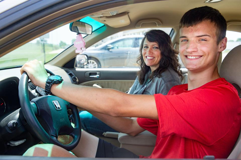 Kaden Kruid and his mother Kelli Kruid in their car in Pella, Friday, July 9, 2021. Kelli is a homeschool parent and taught her oldest son, Kaden, driver's ed last year.