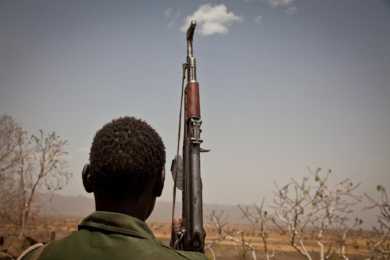 A Sudan People's Liberation Movement rebel soldier looks toward Talodi, in South Kordofan, Sudan, on April 25, 2012