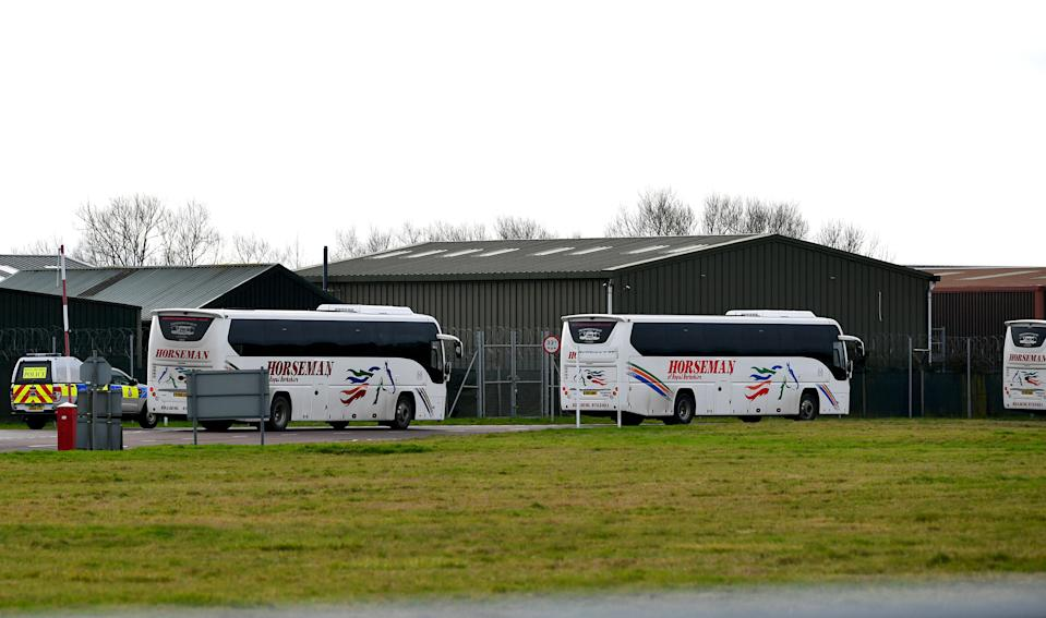 Coaches enter RAF Brize Norton in Oxfordshire, where a plane carrying British nationals from the coronavirus-hit city of Wuhan in China, is due to arrive on Friday. (Ben Birchall/PA Wire)