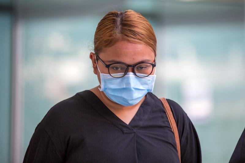 Siti Wan Su'Aidah Samsuri, 25, seen arriving at the State Courts on 21 April 2020. (PHOTO: Dhany Osman / Yahoo News Singapore)