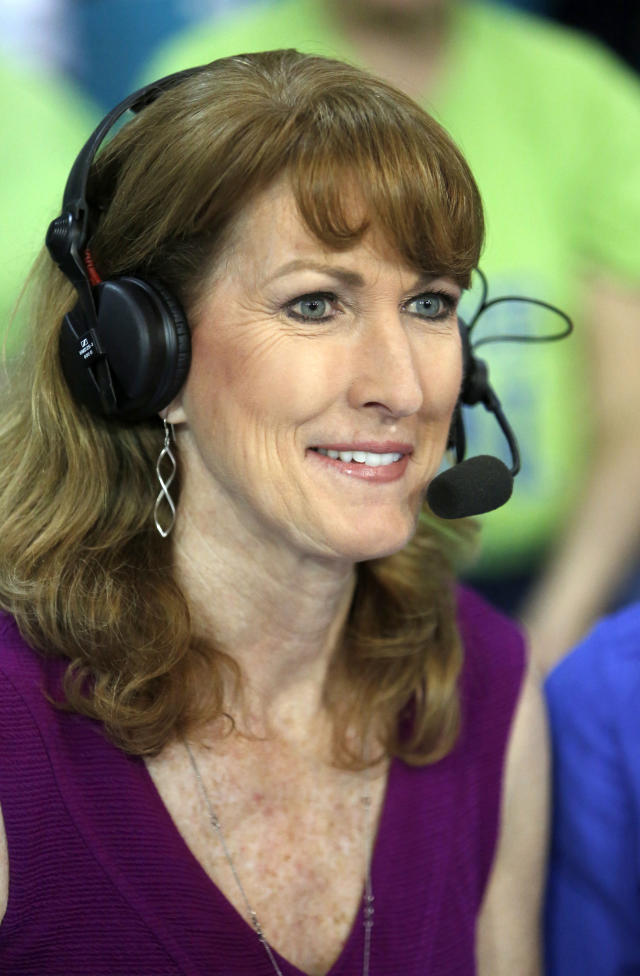 FILE - In this March 5, 2017, file photo, Debbie Antonelli, a women's college basketball analyst for ESPN, listens before a women's NCAA college basketball game between Duke and Notre Dame in Conway, S.C. Antonelli wanted to do something to help raise money and awareness for South Carolina Special Olympics. So about a year ago she came up with the concept of 24 Hours of Nothing But Net. She vowed to make 2,400 free throws for 24 straight hours. She did just that over the weekend, making 2,400 of 2,553 free throws, hitting at 94% accuracy, at the Mount Pleasant Town Hall gym. (AP Photo/Mic Smith, File)