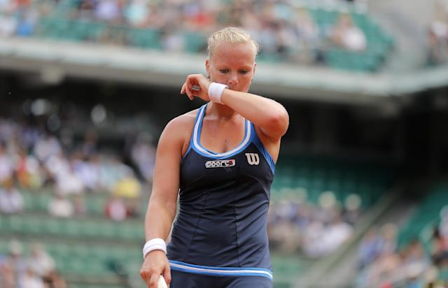 Netherlands' Kiki Bertens reacts as she plays Germany's Andrea Petkovic during their fourth round match of the French Open tennis tournament at the Roland Garros stadium, in Paris, France, Monday, June 2, 2014. (AP Photo/Michel Spingler)