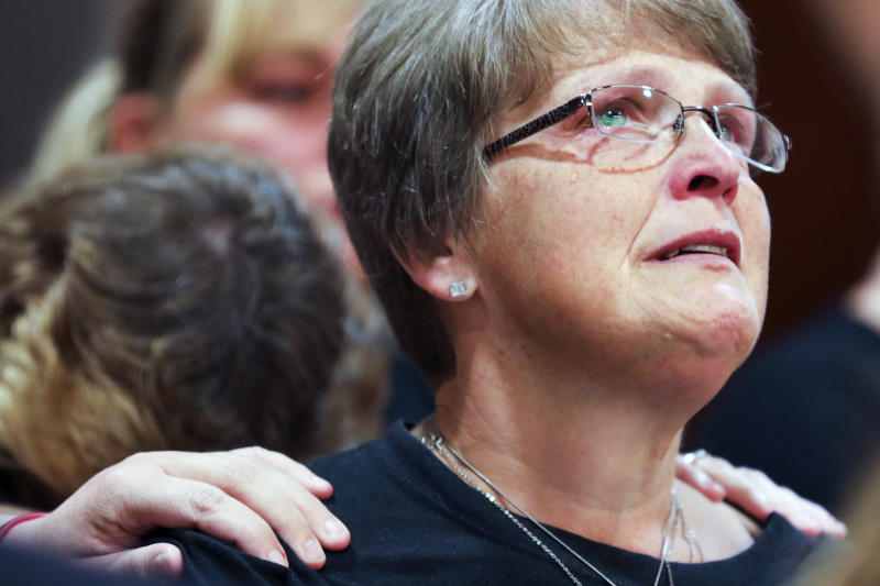 "Kristine Young, mother of Ashley Young, reacts at the sentencing of Jared Chance in Kent County Circuit Court,  Thursday, Oct. 10, 2019, in Grand Rapids, Mich. Chance, a Michigan man convicted of killing and dismembering Ashley Young has been sentenced to at least 100 years in prison after a judge called his actions ""reprehensible and heinous.""(Brian Hayes/The Grand Rapids Press via AP)"
