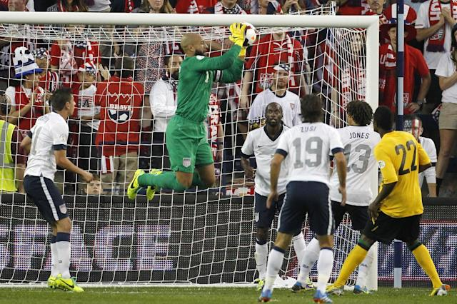 U.S. goalkeeper Tim Howard, center, makes a save on a corner kick by Jamaica in the second half of a World Cup qualifier soccer match at Sporting Park in Kansas City, Kan., Friday, Oct. 11, 2013. The U.S. team won 2-0. (AP Photo/Colin E. Braley)