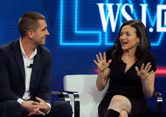 Chris Cox, then Chief Product Officer and Sheryl Sandberg, Chief Operating Officer of Facebook speak at the WSJD Live conference in Laguna Beach, California October 25, 2016. REUTERS/Mike Blake