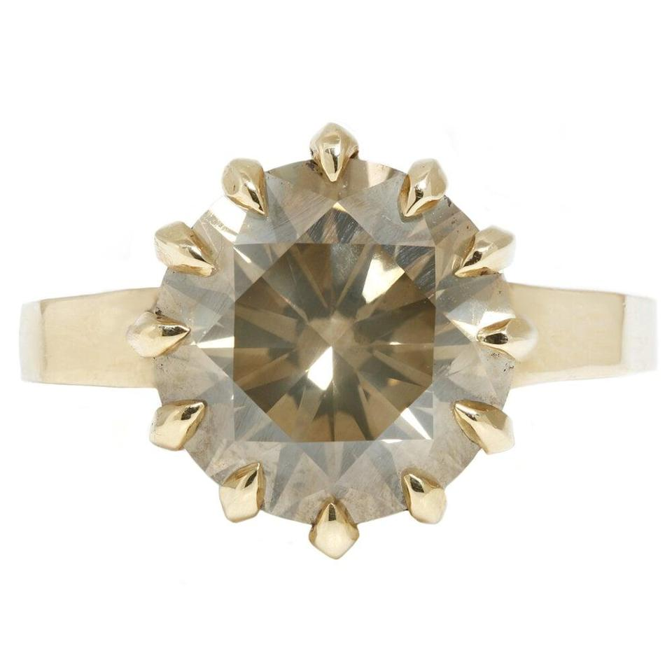 """<p>The <a href=""""https://www.popsugar.com/buy/Green-Brilliance-Solitaire-Ring-532656?p_name=Green%20Brilliance%20Solitaire%20Ring&retailer=laurenwolfjewelry.com&pid=532656&price=30%2C000&evar1=fab%3Aus&evar9=7954958&evar98=https%3A%2F%2Fwww.popsugar.com%2Fphoto-gallery%2F7954958%2Fimage%2F47032934%2FGreen-Brilliance-Solitaire-Ring&list1=shopping%2Cwedding%2Cjewelry%2Crings%2Cengagement%20rings%2Cfashion%20shopping&prop13=api&pdata=1"""" rel=""""nofollow noopener"""" class=""""link rapid-noclick-resp"""" target=""""_blank"""" data-ylk=""""slk:Green Brilliance Solitaire Ring"""">Green Brilliance Solitaire Ring</a> ($30,000) is too cool.</p>"""