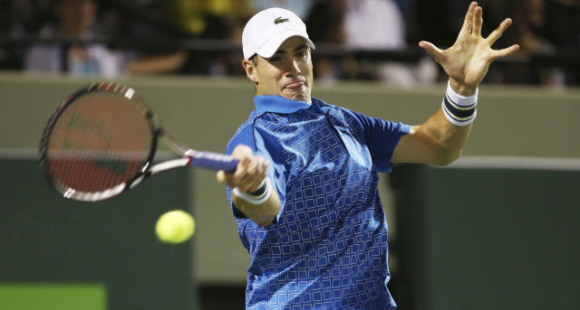 John Isner, of the United States, returns the ball to Nicolas Almagro, of Spain, during the Sony Open Tennis in Key Biscayne, Fla., Monday, March 24, 2014. (AP Photo/J Pat Carter)