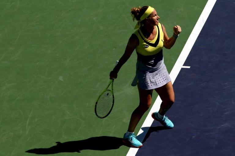 Svetlana Kuznetsova of Russia celebrates a point against Caroline Garcia of France during their BNP Paribas Open last of 16 match, at the Indian Wells Tennis Garden in California, on March 14, 2017