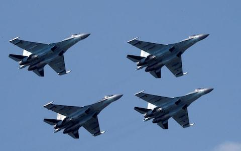 The Trump administration imposed sanctions on the Chinese military for buying Russian missile systems and jets, including the Su-35 combat aircraft pictured here - Credit: Sergei Karpukhin/Reuters