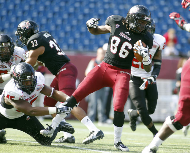 Massachusetts wide receiver Shaquille Harris (86) is tackled by Northern Illinois linebacker Boomer Mays (45) during the first half of an NCAA football game in Foxborough, Mass., Saturday, Nov. 2, 2013. (AP Photo/Stew Milne)