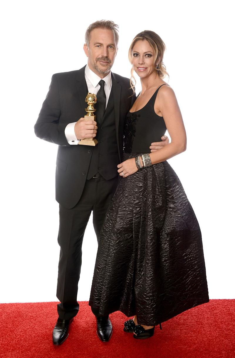 BEVERLY HILLS, CA - JANUARY 13: Actor Kevin Costner, winner of Best Actor in a Mini-Series or a Motion Picture Made for Television for 'Hatfields & McCoys', and wife Christine Baumgartner pose for a portrait at the 70th Annual Golden Globe Awards held at The Beverly Hilton Hotel on January 13, 2013 in Beverly Hills, California. (Photo by Dimitrios Kambouris/Getty Images)