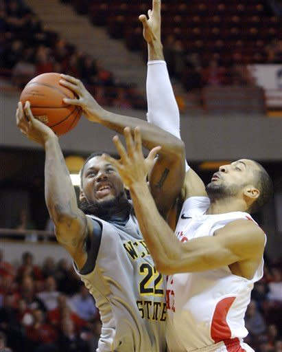 Wichita State forward Carl Hall (22) goes up for a shot against Illinois State forward Jackie Carmichael during the first half of an NCAA college basketball game Wednesday, Feb. 22, 2012, in Normal, Ill. (AP Photo/The Pantagraph, David Proeber)