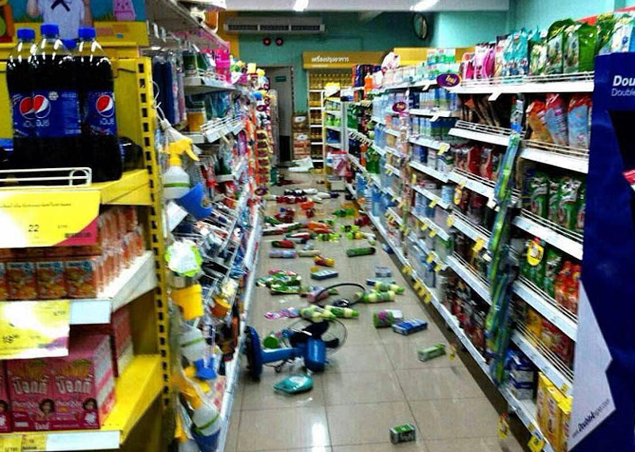 Goods at a grocery store fallen from from the shelves after an earthquake in Chiang Rai province, northern Thailand Monday, May 5, 2014. A strong earthquake shook northern Thailand and Myanmar on Monday evening, and some light damage was reported. (AP Photo)