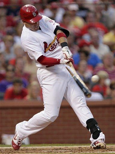 St. Louis Cardinals' Allen Craig shatters his bat as he lines out in the third inning of a baseball game against the Colorado Rockies, Tuesday, July 3, 2012 in St. Louis.(AP Photo/Tom Gannam)