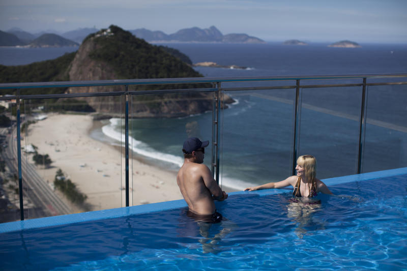 Tourists wade in a pool at a hotel in Copacabana in Rio de Janeiro, Brazil, Thursday, May 10, 2012. Host city for the Rio + 20 conference, Rio de Janeiro's hotel infrastructure is woefully lacking. With a total of just 33,000 beds for the estimated 50,000-plus visitors expected to flood the city for the June 20-22 summit, the mayor resorted to begging residents to leave town and rent out their apartments. (AP Photo/Felipe Dana)