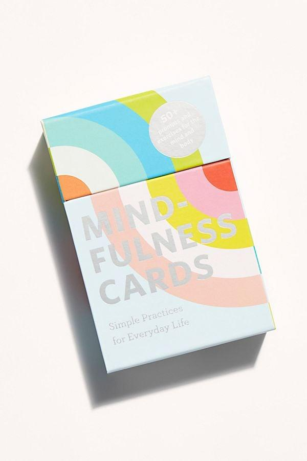 """<p>Whenever you feel like your mind is racing, pull out the <a href=""""https://www.popsugar.com/buy/Mindfulness-Cards-560049?p_name=Mindfulness%20Cards&retailer=freepeople.com&pid=560049&price=17&evar1=fit%3Aus&evar9=47311867&evar98=https%3A%2F%2Fwww.popsugar.com%2Ffitness%2Fphoto-gallery%2F47311867%2Fimage%2F47311870%2FMindfulness-Cards&list1=stress%20relief%2Chealthy%20living%2Cself-care%2Cfitness%20shopping&prop13=api&pdata=1"""" rel=""""nofollow"""" data-shoppable-link=""""1"""" target=""""_blank"""" class=""""ga-track"""" data-ga-category=""""Related"""" data-ga-label=""""https://www.freepeople.com/shop/mindfulness-cards/?category=wellness-products&amp;color=000"""" data-ga-action=""""In-Line Links"""">Mindfulness Cards</a> ($17) for an inspiring phrase and a mini mindfulness exercise. </p>"""