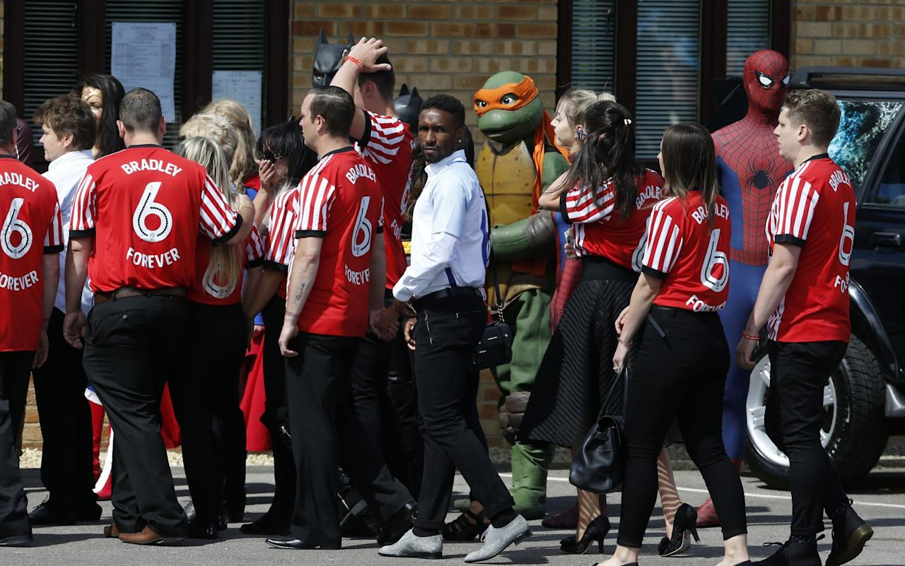 <p>Jermain Defoe (centre) during the funeral of Bradley Lowery </p>