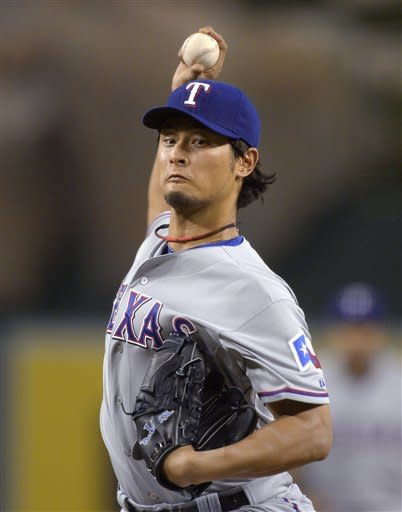 Texas Rangers starting pitcher Yu Darvish throws to a Los Angeles Angels batter during the second inning of a baseball game Thursday, Sept. 20, 2012, in Anaheim, Calif. (AP Photo/Mark J. Terrill)