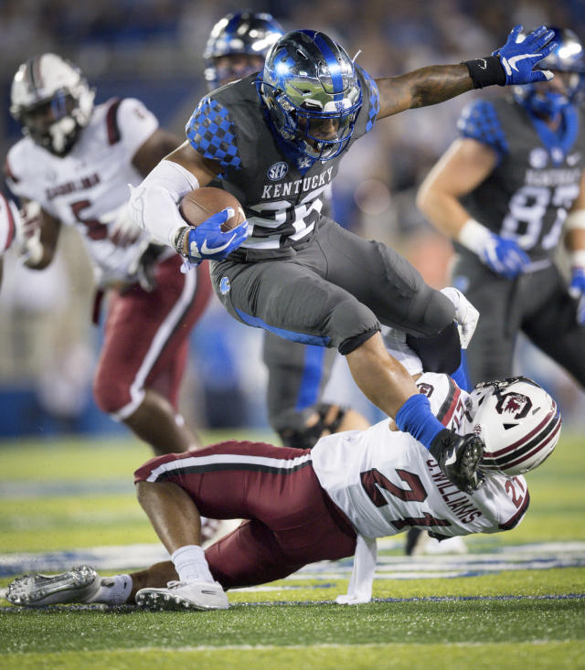 Kentucky running back Benny Snell Jr. (26) leaps over South Carolina defensive back Jamyest Williams (21) during the first half of an NCAA college football game in Lexington, Ky., Saturday, Sept. 29, 2018. (AP Photo/Bryan Woolston)