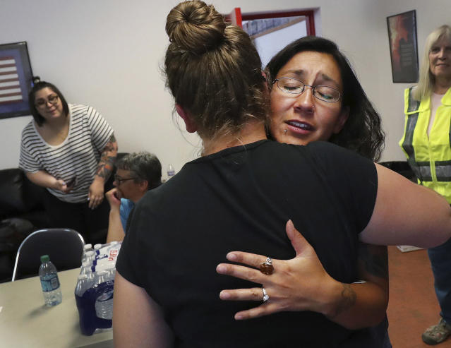 <p>Red Cross volunteer Monica Sierra hugs a friend in Moab, Utah, on Wednesday, June 13, 2018. (Photo: Jeffrey D. Allred/The Deseret News via AP) </p>