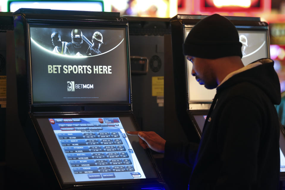 A patron enters his bet during the launch of legalized sports betting in Michigan at the MGM Grand Detroit casino in Detroit earlier this year. (AP Photo/Paul Sancya)