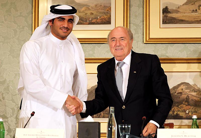DOHA, QATAR - NOVEMBER 9: FIFA President Sepp Blatter (R) and the Chairman of Qatar 2022 bid committee Sheik Mohammed bin Hamad al-Thani (L) hold a press conference on November 9, 2013 in Doha, Qatar. Blatter mentioned, he would favour playing the 2022 Qatar World Cup in November and December. (Photo By Mohamed Farag/Anadolu Agency/Getty Images)