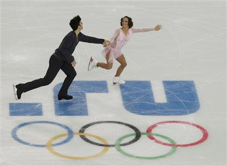 Meagan Duhamel and Eric Radford of Canada compete during the Team Pairs Short Program at the Sochi 2014 Winter Olympics, February 6, 2014. REUTERS/David Gray