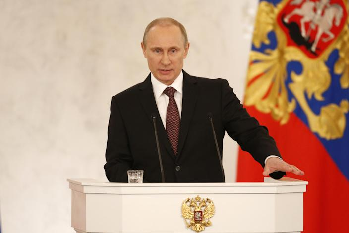 Russia's President Vladimir Putin addresses the Federation Council in Moscow's Kremlin on Tuesday, March 18, 2014. President Vladimir Putin defended Russia's move to annex Crimea, saying that the rights of ethnic Russians have been abused by the Ukrainian government. He pointed at the example of Kosovo's independence bid supported by the West, and said that Crimea's secession from Ukraine repeated Ukraine's own secession from the Soviet Union in 1991. (AP Photo/Alexander Zemlianichenko)