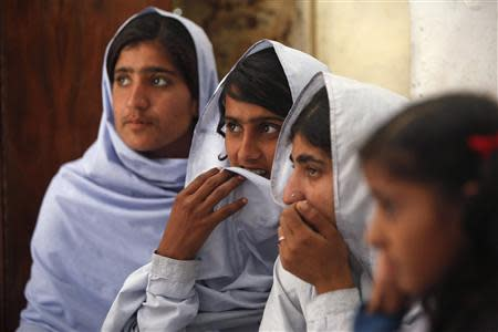 Students react while attending a lecture on preventive measures to take when sexual harassment occurs, during a class in Shadabad Girls Elementary School in Pir Mashaikh village in Johi, some 325 km (202 miles) from Karachi February 12, 2014. REUTERS/Akhtar Soomro