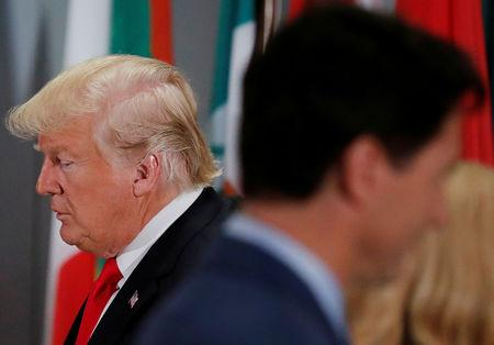 FILE PHOTO: U.S. President Donald Trump passes by Canadian Prime Minister Justin Trudeau during a working luncheon for world leaders at the 73rd session of the United Nations General Assembly at U.N. headquarters in New York, U.S., September 25, 2018. REUTERS/Carlos Barria/File Photo