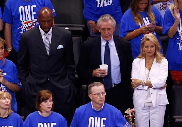 OKLAHOMA CITY, OK - JUNE 12: Miami Heat Executive Alonzo Mourning, Heat President Pat Riley and wife Chris Riley watch Game One of the 2012 NBA Finals at Chesapeake Energy Arena on June 12, 2012 in Oklahoma City, Oklahoma. NOTE TO USER: User expressly acknowledges and agrees that, by downloading and or using this photograph, User is consenting to the terms and conditions of the Getty Images License Agreement. (Photo by Mike Ehrmann/Getty Images)