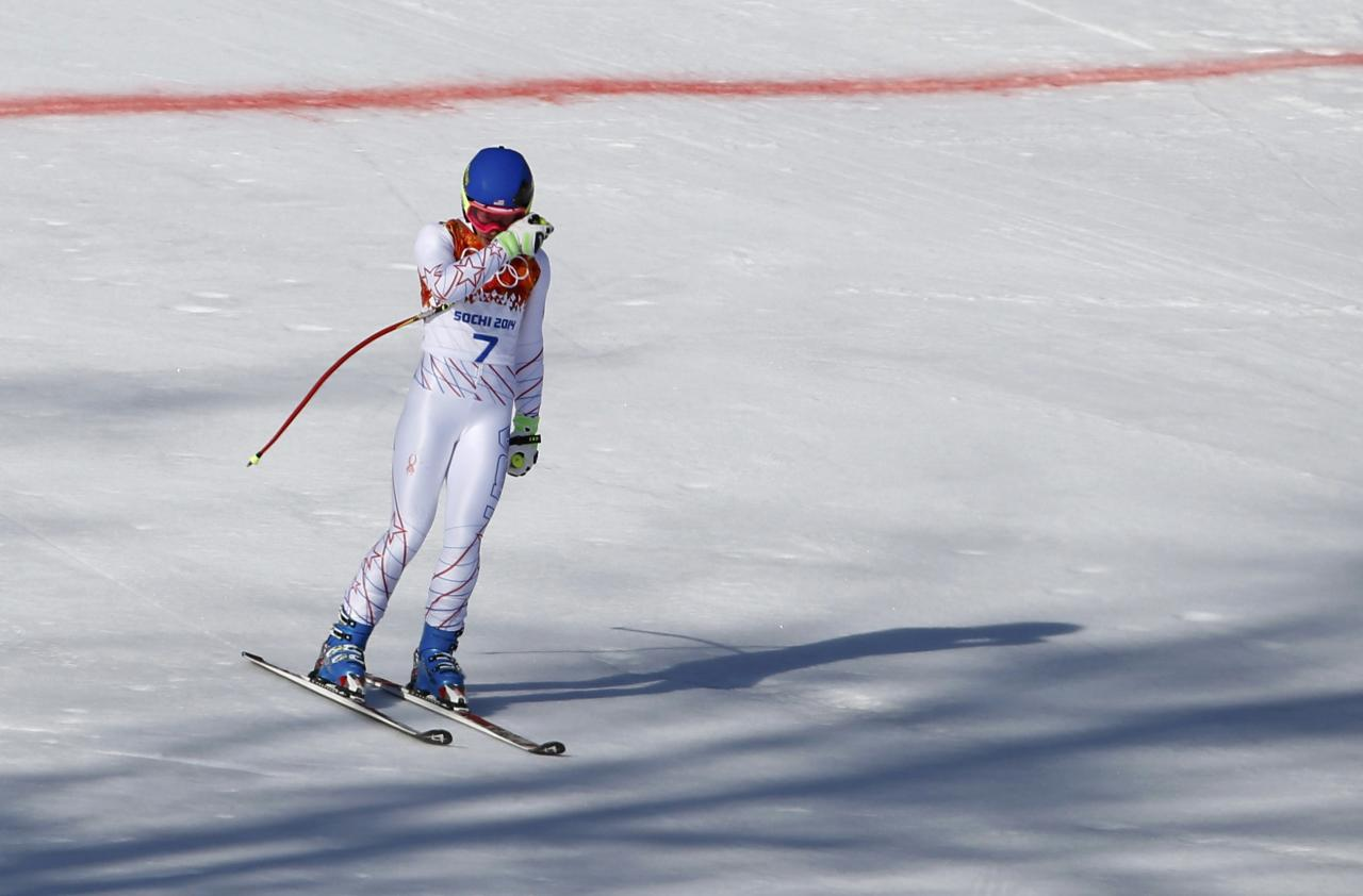 Laurenne Ross of the U.S. reacts after skiing out during the women's alpine skiing Super G competition during the 2014 Sochi Winter Olympics at the Rosa Khutor Alpine Center February 15, 2014. REUTERS/Leonhard Foeger (RUSSIA - Tags: SPORT OLYMPICS SPORT SKIING)