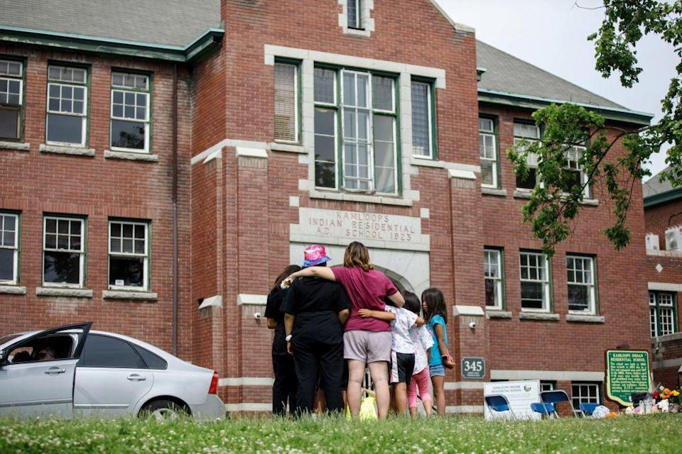 The former Kamloops Indian Residential School where a makeshift memorial honored 215 children whose remains were discovered buried nearby in  Kamloops, British Columbia, Canada, on June 3, 2021. / Credit: COLE BURSTON/AFP via Getty