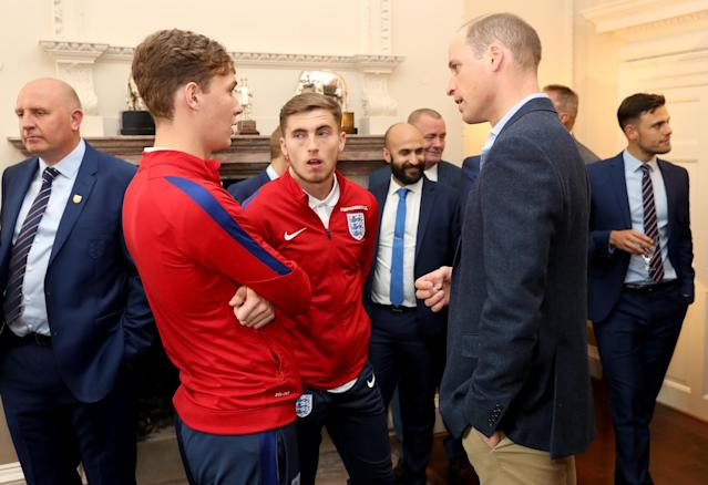 LONDON, ENGLAND - SEPTEMBER 07: Prince William, Duke of Cambridge (R) President of the Football Association, speaks with Kieran Dowell (L) and Jonjoe Kenny (C) during a reception for the Under-20 England Football Team at Kensington Palace on September 7, 2017 in London, England. The England Under-20 side became the first England team to win a football World Cup since 1996 when they beat Venezuela 1-0 on June 11th, 2017. (Photo by Chris Jackson - WPA Pool/Getty Images)