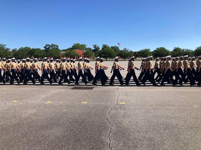 New Marines march in parade formation during Parris Island graduation May 7, 2021.