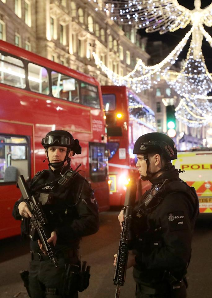 Armed police officers stand on Oxford Street, London, Britain November 24, 2017.  REUTERS/Simon Dawson