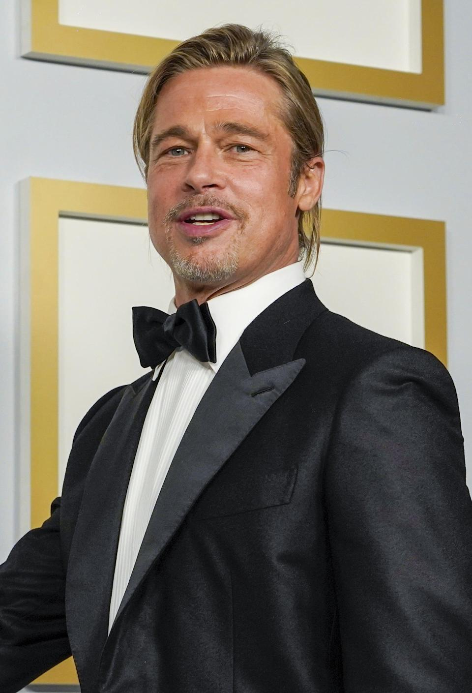 <p>Get a load of that lift at his roots. His hair doesn't look one bit matted down or greasy like mine usually does when I try to pull off a casual low bun. Bravo, Pitt - bravo. And those piecey, face-framing strands. He knows what he's doing.</p>