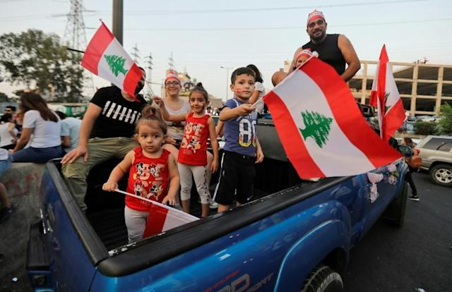Protesters and children take to the streets during demonstrations to demand better living conditions and the ouster of a cast of politicians who have monopolised power and influence for decades in Zouk Mosbeh, Lebanon (AFP Photo/JOSEPH EID)