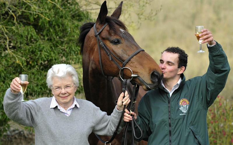 2009 Grand National winner Mon Mome with winning jockey Liam Treadwell and owner Vida Bingham - Credit: PA