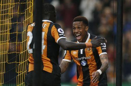 Hull City's Oumar Niasse celebrates scoring their second goal with Hull City's Abel Hernandez