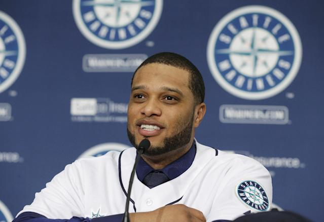 Robinson Cano talks to reporters after he was introduced as the newest member of the Seattle Mariners baseball team, Thursday, Dec. 12, 2013, in Seattle. (AP Photo/Ted S. Warren)