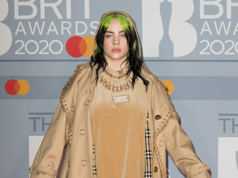 Billie Eilish slams body shamers as she sheds oversized clothes for tour video